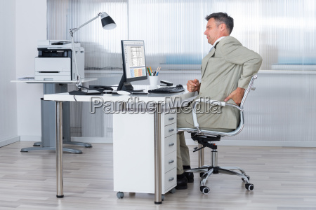 accountant suffering from back pain at