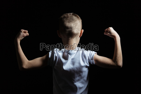 silhouette of a boy showing arm
