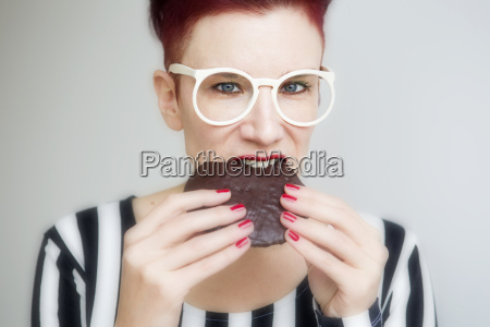 red haired woman eating a big