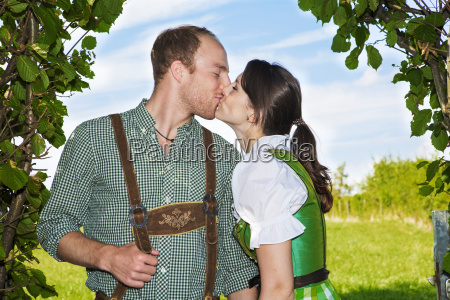 bavarian, couple, kissing, each, other - 15945565