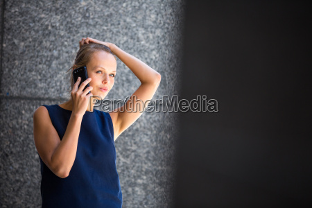 pretty young businesswoman talking on the