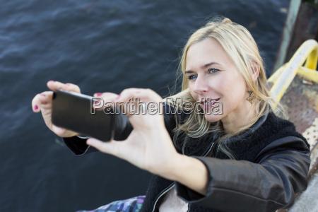blond woman taking a selfie