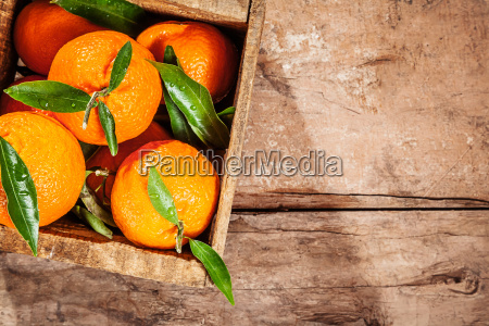 wooden crate of fresh colorful clementines