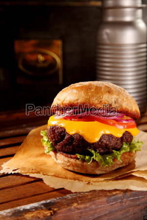 super sized cheeseburger on table