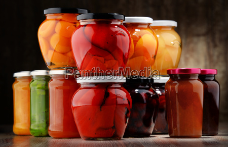 jars with fruity compotes and jams