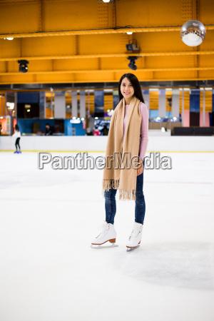 asian woman on skating rink