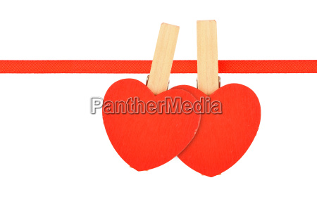 two red hearts at ribbon isolated