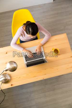 top view of young woman working