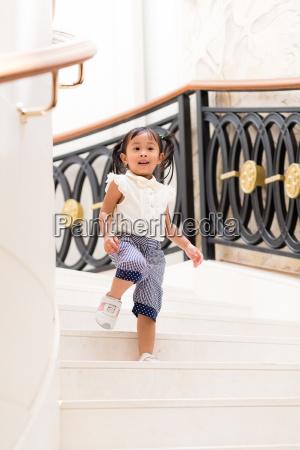 little girl walking downstair