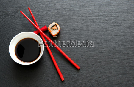 soy sauce with red chopsticks