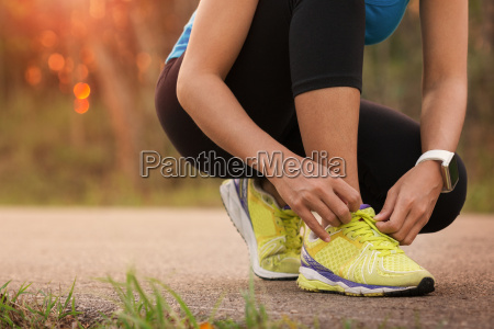 woman tying sport shoes ready for