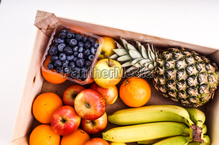 wood crate filled with organic ripe