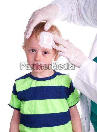 boy has injury on forehead and