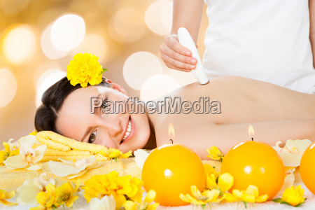 woman receiving microdermabrasion therapy at spa