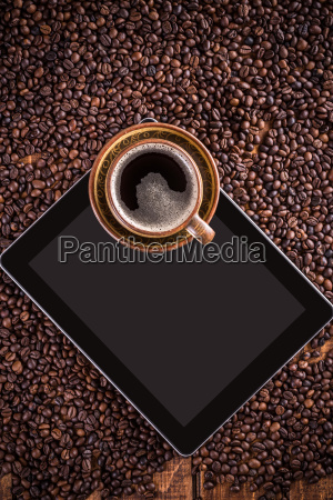 digital tablet and coffee cup