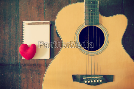 notebook and wooden pencil with heart
