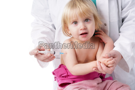 doctor gives baby girl an injection