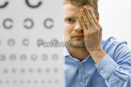 eyesight check male patient under eye