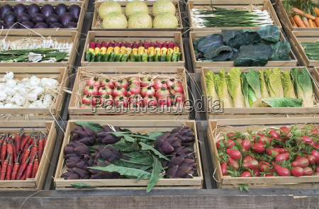 various vegetables in wooden crates