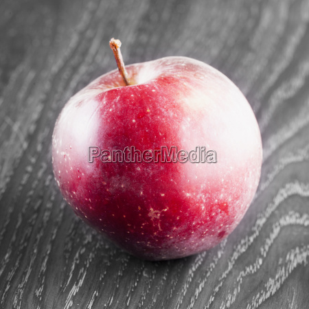 red apple over black and white
