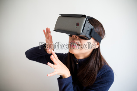asian woman wear with vr device