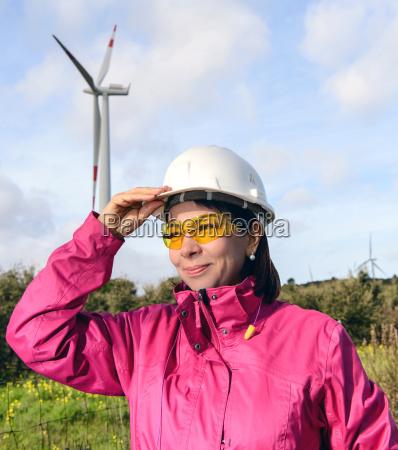 woman engineer checking wind turbines