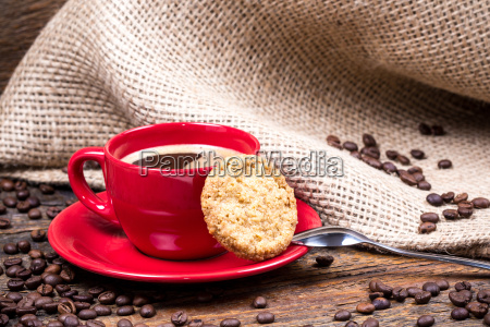 coffee cup with biscuit spoon and