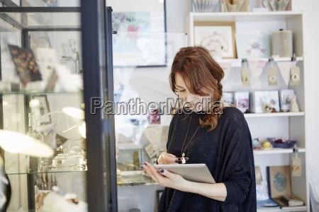 a mature woman using a digital