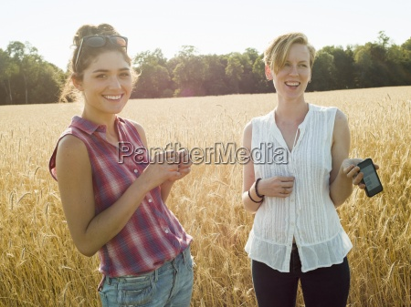 two smiling young women standing in