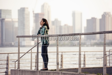 a woman standing on the waterfront
