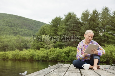 a woman sitting outdoors on a