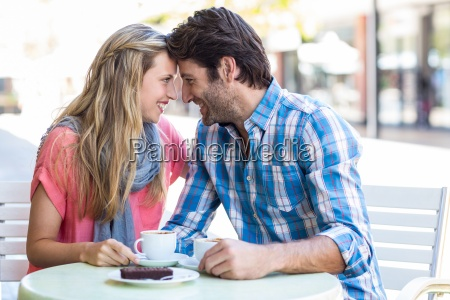 cute couple sitting at a cafe