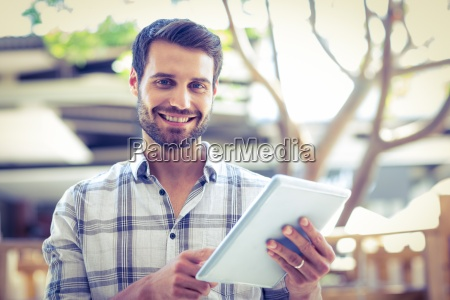hipster man using tablet computer in