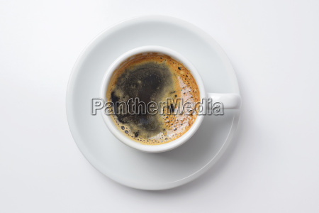 single cup of coffee with empty