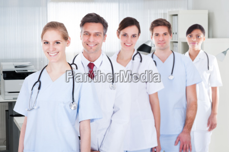 doctors and nurses standing in a