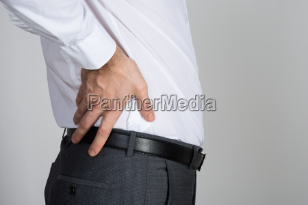 rear view of businessman suffering from