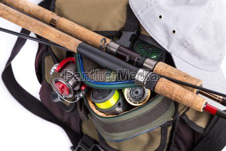 tackles in handbag with cap
