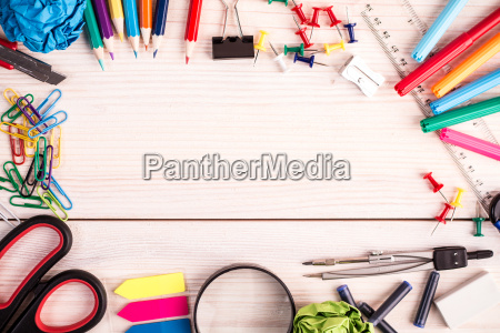 office supplies on wooden background