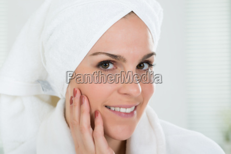 woman with towel wrapped on head