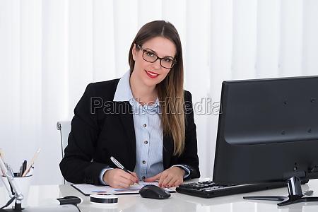 businesswoman analyzing financial report