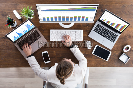 businesswoman working with graphs on computer