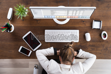 businesswoman sleeping at workplace