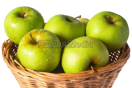 green apples in a wicker basket