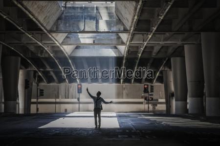 a man in an urban underpass