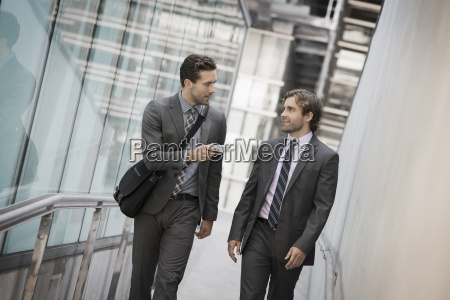 two men in business suits outside