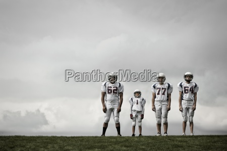 a group of four football players