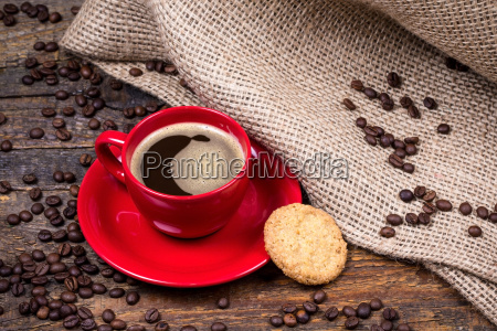 coffee cup with biscuit and