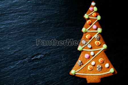 gingerbread christmas tree on black with