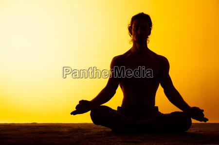 the man practicing yoga in the
