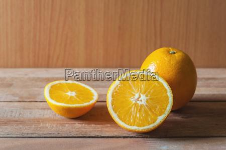 orange fruit and slice in still
